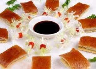 片皮乳猪的做法及介绍---千米饮食网